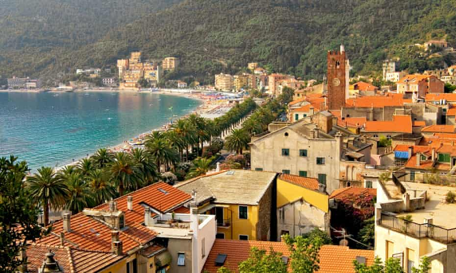 Coast of many colours: view over the beach and houses of medieval-walled Noli.