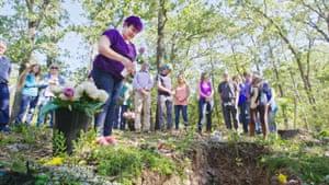 Woman placing flower into Barbara Jean's grave in Alternate Endings