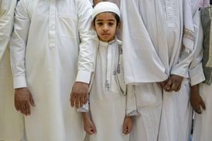 A boy attends Eid al-Fitr prayers in Bucharest, Romania