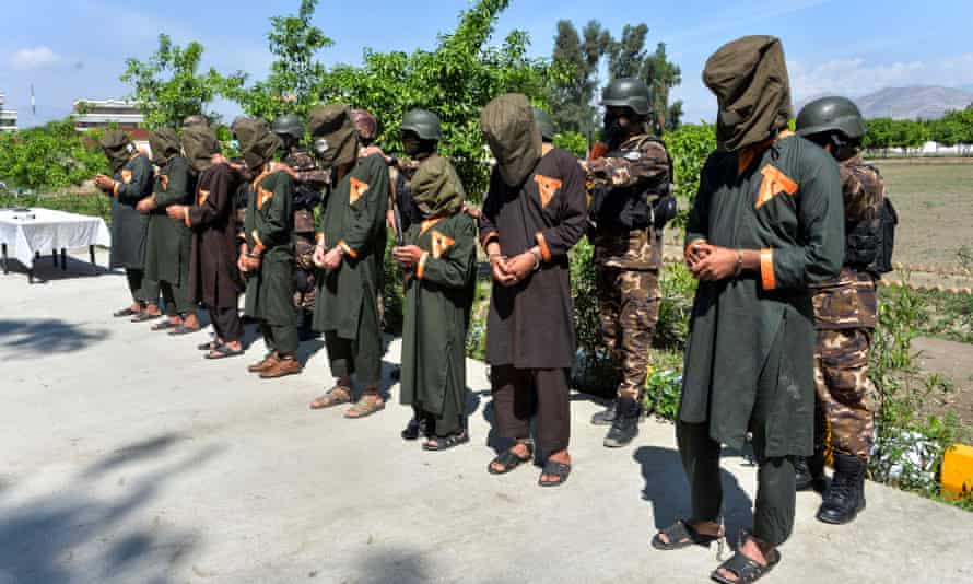 Afghan security forces with arrested alleged Isis fighters on 10 April 2019.