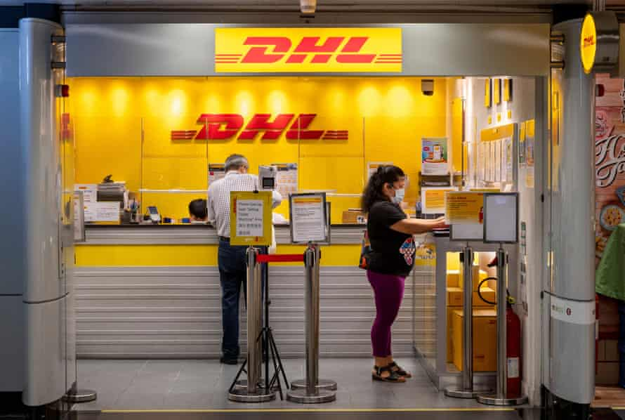 Customers are seen in the DHL store of the German express delivery company in Hong Kong.