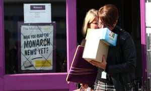 Monarch Airlines staff leave a training centre at London Luton airport