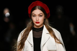 'Her red beret matched to her lipstick and her kitten heels' … Gigi Hadid on the catwalk.