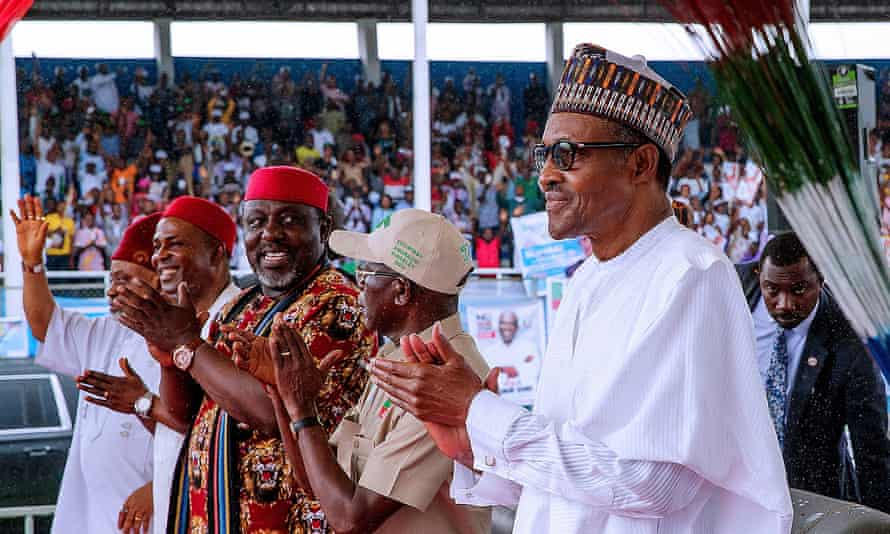 Nigerian President Muhammadu Buhari, right, at a campaign rally in Aba on 29 January ahead of elections in February.