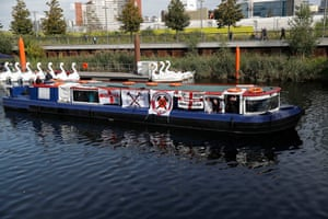 A party of West Ham fans arrive by boat
