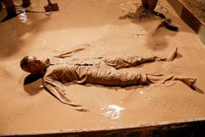 Man rolls in mud