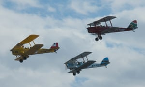 Biplanes take to the sky as the rally gets under way.