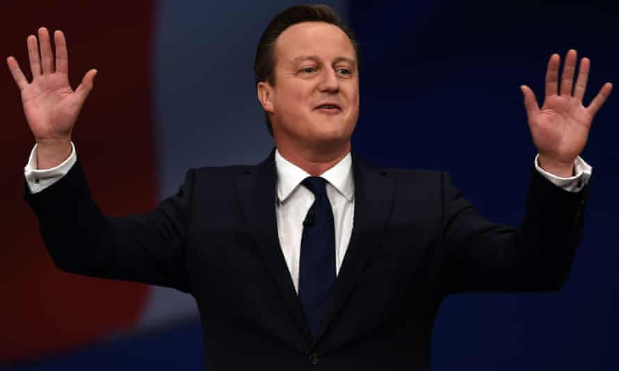 David Cameron with hands up