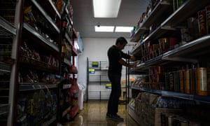 Journalist Carlos stocking shelves. Most undocumented Venezuelans only can find informal employment and are an easy prey for labor exploitation.