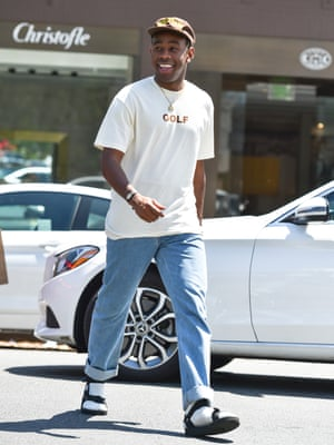 Tyler the Creator in white socks and sandals.
