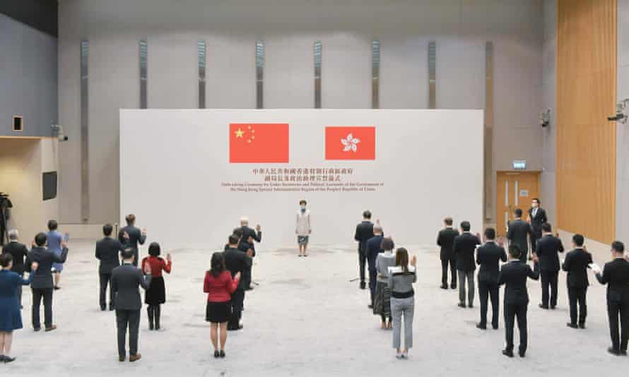 Hong Kong's chief executive Carrie Lam oversees an oath-taking ceremony for under secretaries and political assistants.