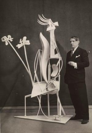 Picasso with his sculpture La Femme au Jardin, 1932.
