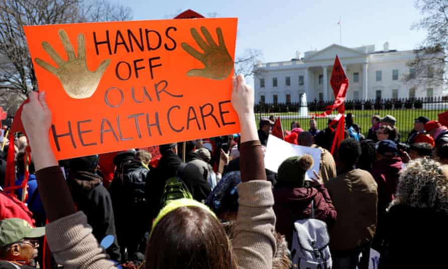 Protesters demonstrate against Donald Trump's plans to end Obamacare outside the White House in Washington on 23 March 2017.