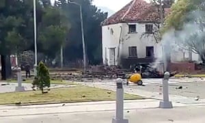 Smouldering remains of car bomb are seen in this screengrab outside Bogota Police Academy.