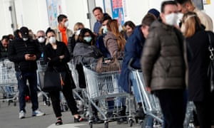 People queue at a supermarket outside the town of Casalpusterlengo, which was closed by the Italian government due to a coronavirus