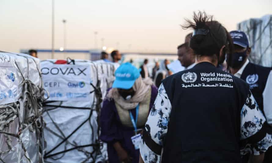 Coronavirus vaccine doses are unloaded from a plane at Khartoum airport in Sudan
