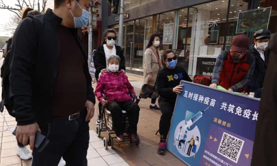 A stand promoting Chinese coronavirus vaccines in Beijing
