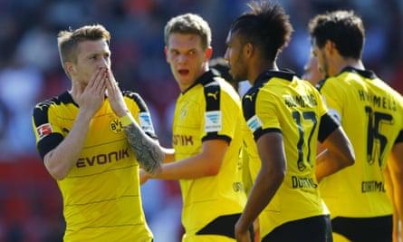 Dortmund's Marco Reus, left, celebrates after he scored his sides second goal against Ingolstadt.