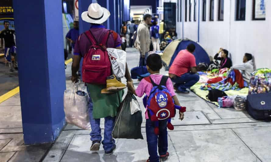 A Venezuelan and his son arrive in Tumbes, Peru, to claim refugee status.