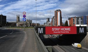 A road sign in Manchester alerts motorists to stay home