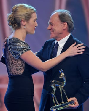 Kate Winslet hugs Bruno Ganz as he presents her with a Bambi award for her role in the movie The Reader