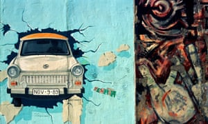 Paintings of a Trabant breaking through the Wall by Birgit Kinder and Hands by Margaret Hunter