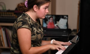 Fourteen-year-old Mikaela Gonzalez receives a piano lesson via Zoom at her home in Brisbane