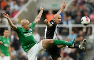 Brighton and Hove Albion's Aaron Mooy tussling with Newcastle United's Jonjo Shelvey as Newcastle and Brighton played out a goalless draw at St James' Park.