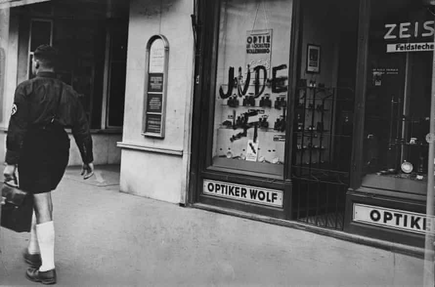 A Jewish-owned optician's shop in Austria marked by the Nazis with the word 'Jew' and a swastika.