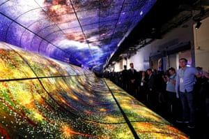 Las Vegas, Nevada, USAttendees watch a display made up of curved OLED television screens at the LG Electronics booth during the 2019 CES