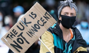 Demonstrator at a Black Lives Matter protest n Cardiff with a placard reading: 'The UK is not innocent'.