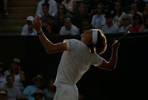Germany's Alexander Zverev serves against Milos Raonic.