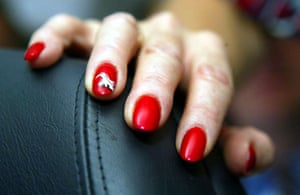 A flight attendant has Concorde-themed nails