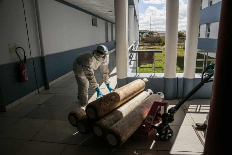Health personnel move oxygen cylinders for the most severely affected coronavirus patients at the Andohatapenaka University hospital in Antananarivo, Madagascar.