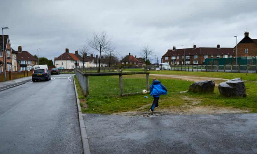 Child kicking a ball in Knowsley, one of the most deprived areas in the county