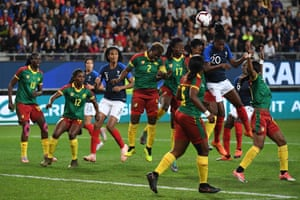 France's defender Kadidiatou Diani heads the ball during the match against Cameroon at the Stade des Alpes.