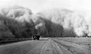 Depression to Dust Bowl: a large cloud appears behind a truck travelling on Highway 59 in Colorado, May 1936.