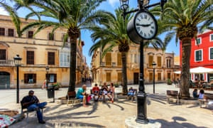 Tourists relaxing on Plaza Alfonzo III, at Ciutadella, on the island of Minorca, Spain