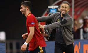 Ferran Torres is congratulated by Spain head coach Luis Enrique as he comes off the field.