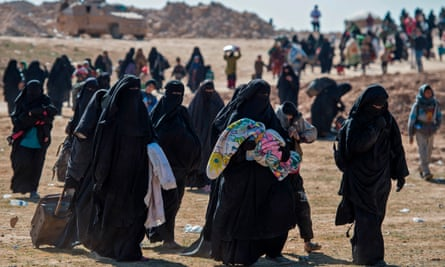Women and children flee Baghouz in Syria on 12 February after the latest US-backed operation to expel Islamic State.