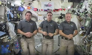 Bob Behnken, left, and Doug Hurley, right, on the International Space Station. Chris Cassidy, centre, will remain on board.