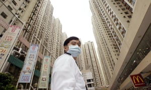 No system overhaul ... a security guard outside a quarantined housing estate in Hong Kong during the Sars outbreak.