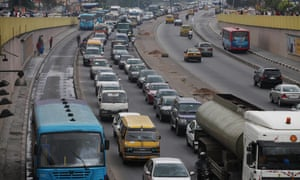 Traffic in Lagos adds hours to working days and contributes to the city's choking air pollution