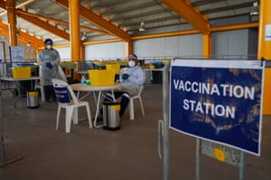 Health workers in Port Moresby prepare to administer vaccines to the Papua New Guinea PM and other politicians
