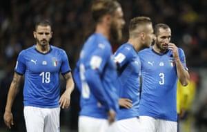 Leonardo Bonucci, Daniele De Rossi, Ciro Immobile and Giorgio Chiellini look dejected.