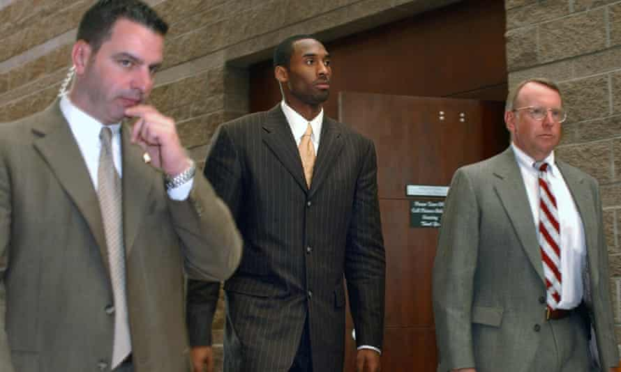 Kobe Bryant prepares to leave for a lunch break from proceedings in his sexual assault case as members of his security team accompany him, in Eagle, Colorado, on 24 March 2004.