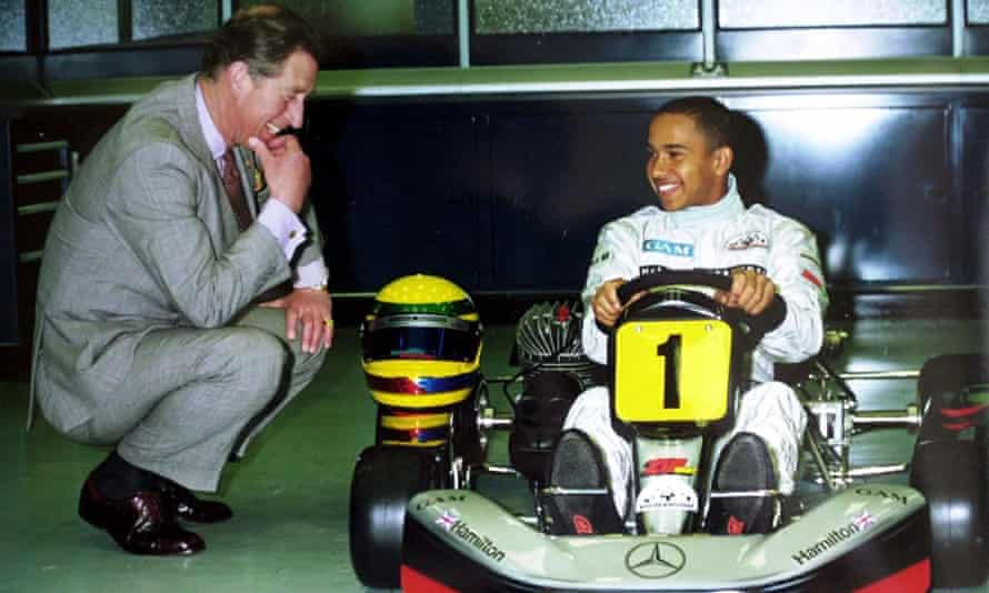 Hamilton meeting Prince Charles at the McLaren headquarters in 1999.