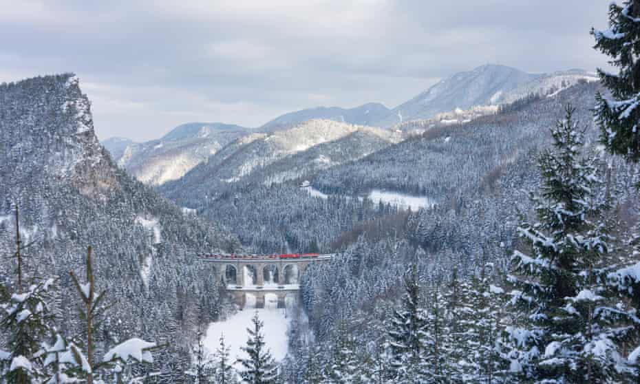 The Semmering Railway with the Kalte-Rinne-Viadukt (viaduct), wall Polleroswand, train, view to mountain