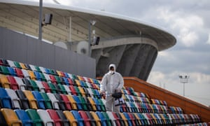 Seats are disinfected outside the Ataturk Olympic Stadium in Istanbul, which was due to host the Champions League final on 30 May.