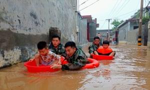Children in makeshift boats